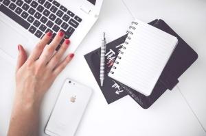 woman-hand-smartphone-desk-large